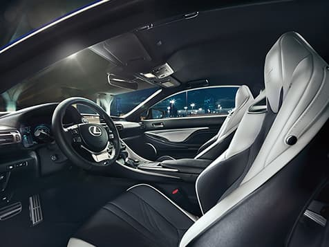 Interior of 2020 RC F shown with White and Black leather and Black Carbon Fiber trim.
