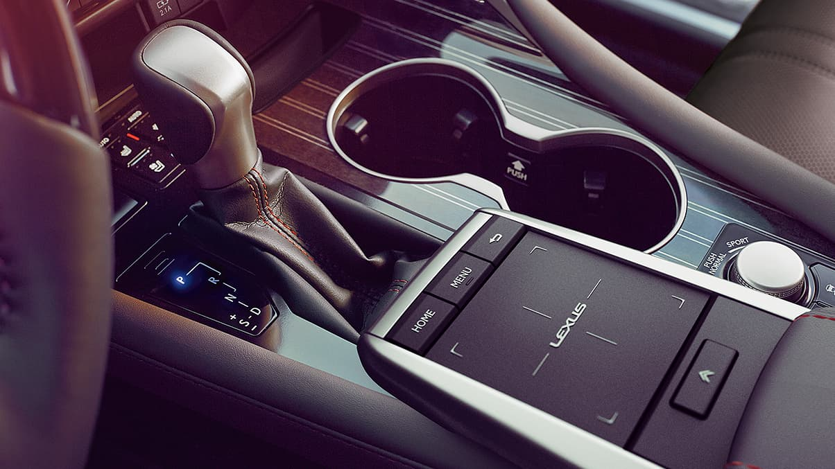 Interior of the Lexus RX shown with Gray Sapele Wood trim.