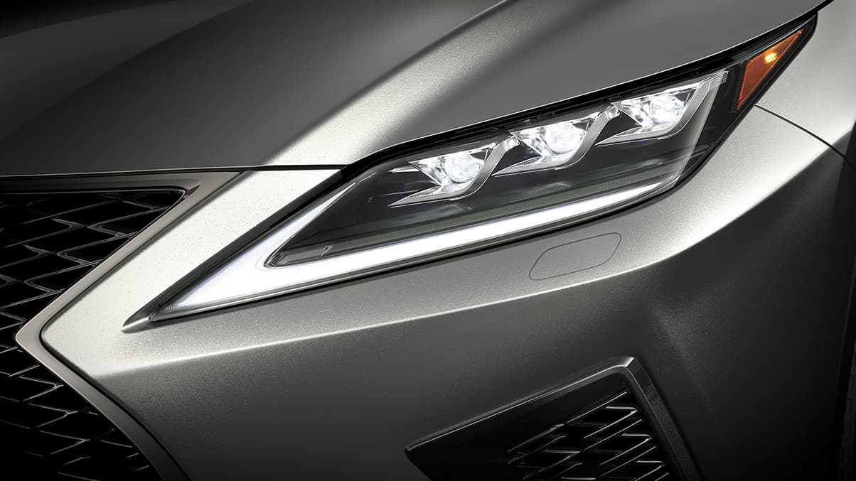 Lexus RX F SPORT shown with available Premium Triple-Beam LED headlamps.