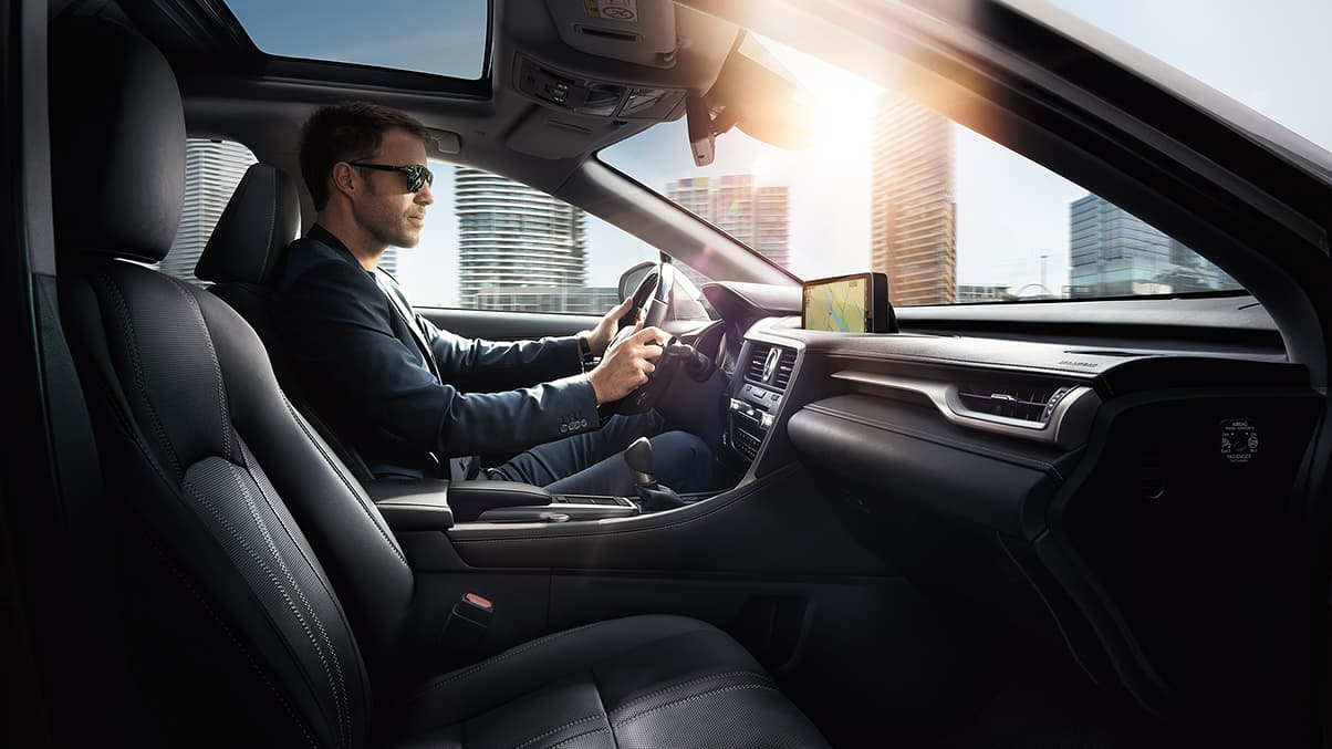 Interior of the Lexus RX Hybrid shown with Black semi-aniline leather and Gray Sapele Wood with Aluminum interior trim.