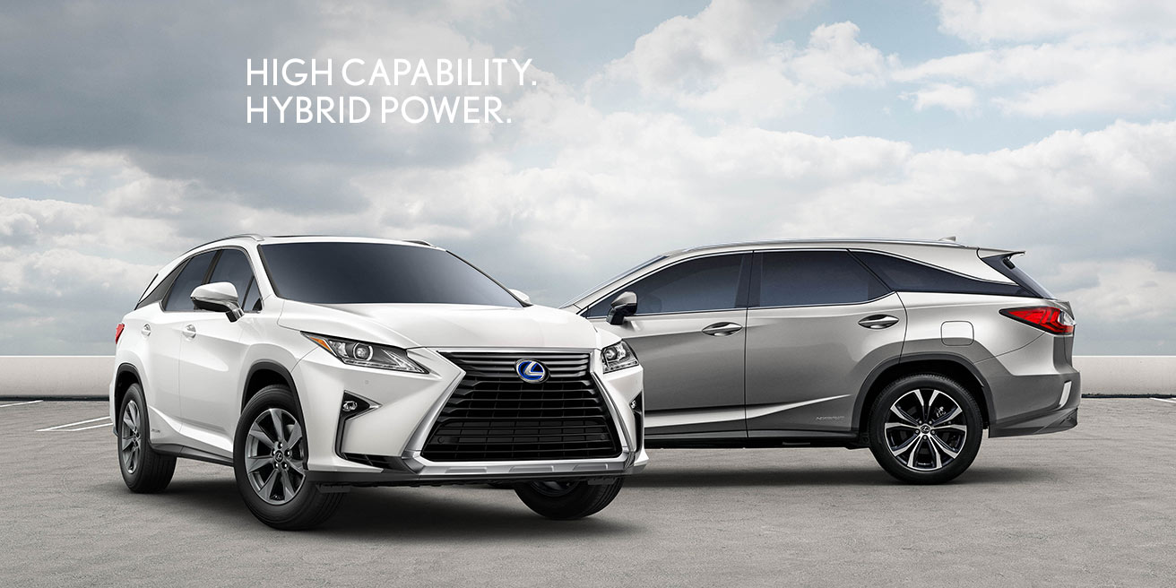 Exterior shot of the 2019 Lexus RXh shown in Eminent White Pearl and the 2019 Lexus RXhL shown in Atomic Silver.