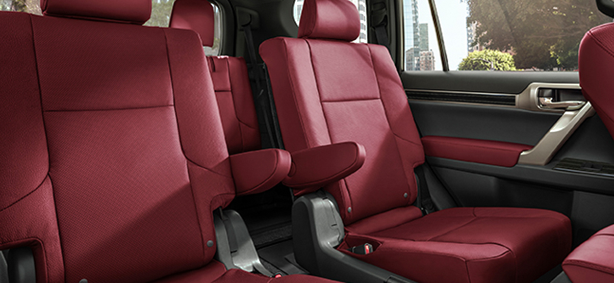 Interior of the Lexus GX shown in Rioja Red semi-aniline leather with Gray Sapele wood with Aluminum trim.