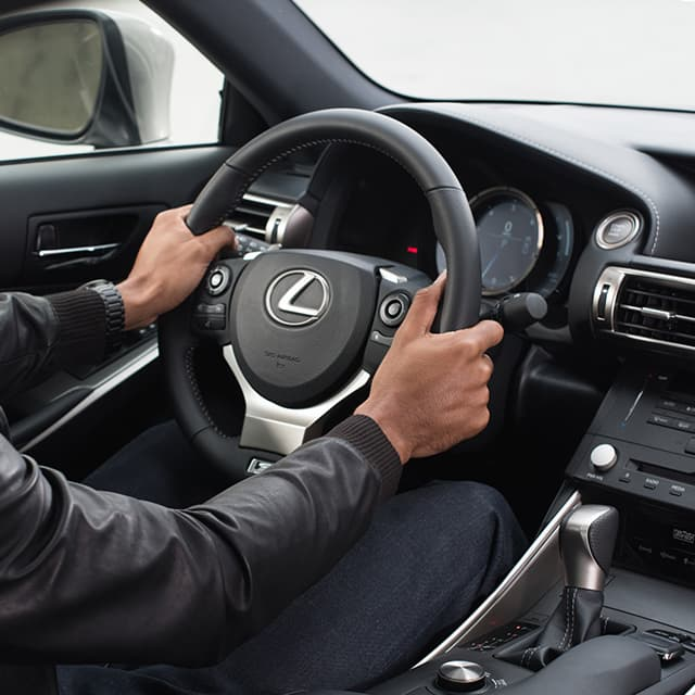 Lexus Drivers.com Owners Benefit displays a driver's hands on the steering wheel of a Lexus.