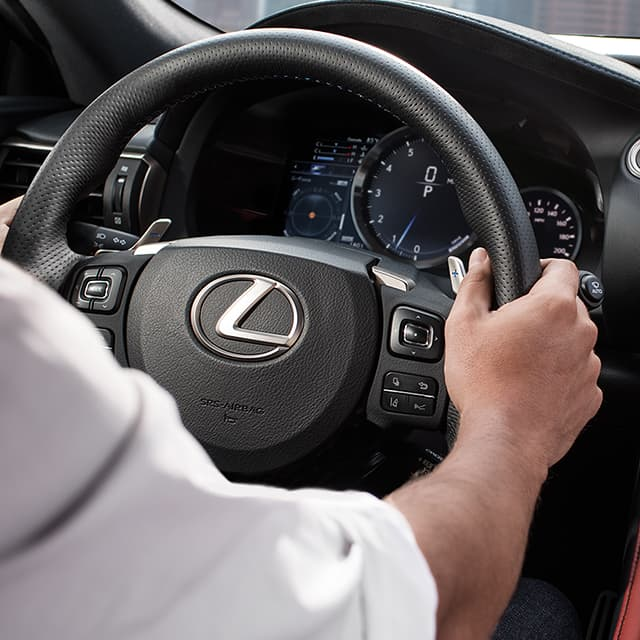 Technology Specialists photo showing Lexus App Suite and navigation on multimedia display.