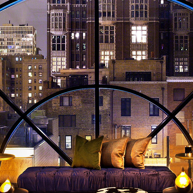 A nighttime city skyline is shown from inside a hotel room displaying 'Hotel Partners' as an Owners Benefit.
