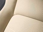 Perforated leather-trimmed interior detail shot.