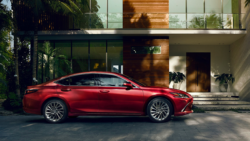 Lexus ES shown in Matador Red Mica.
