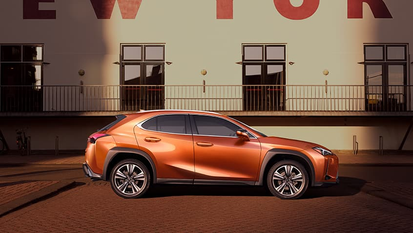 Lexus UX shown in Cadmium Orange.