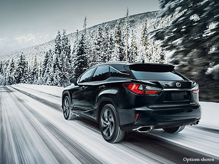 Exterior shot of the 2018 Lexus RX shown in Obsidian