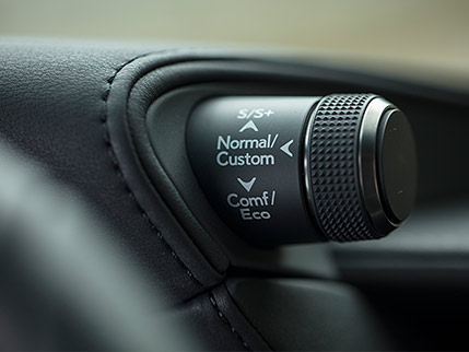 Interior of the Lexus LS showing the Drive Mode Select knob.