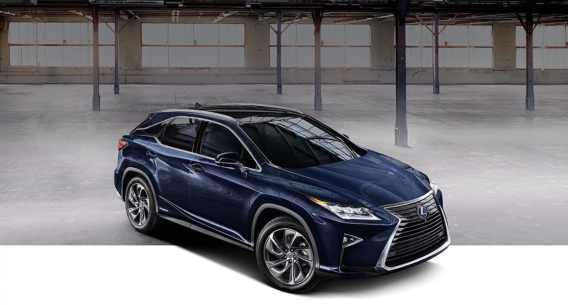 Exterior shot of the 2019 Lexus RX 450h shown in Nightfall Mica