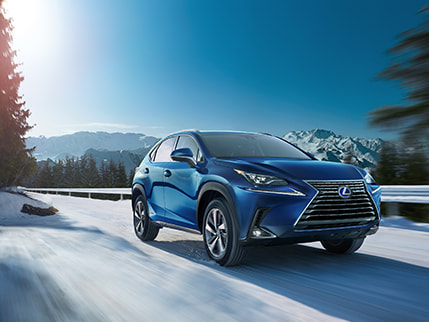 Lexus NX Hybrid shown in Blue Vortex Metallic.