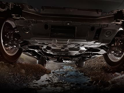 Undercarriage of the Lexus GX shown to illustrate the Off-Road Package.