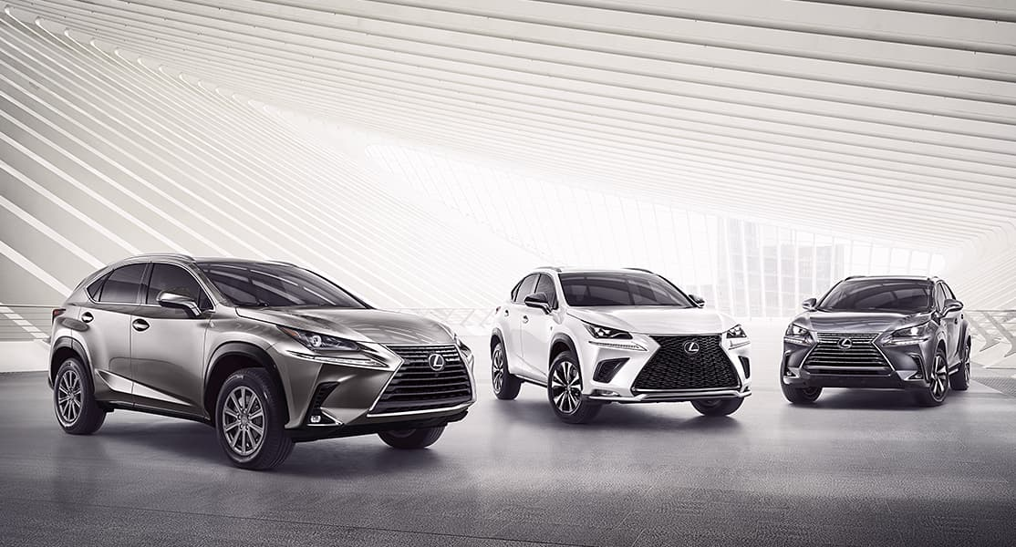 Three Lexus NX and NX F SPORT models shown in Atomic Silver, Ultra White and Nebula Gray Pearl.