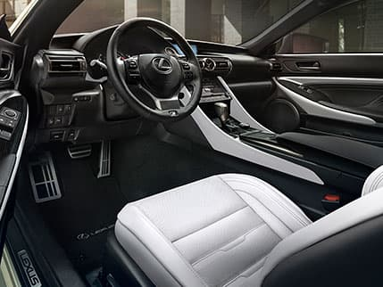 Interior of the Lexus RC F SPORT shown in White NuLuxe with Dark Gray Streamline trim.
