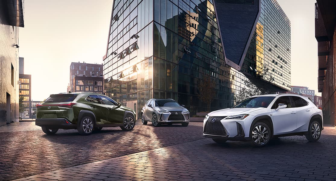 Lexus UX Hybrid shown in Nori Green Pearl, Lexus UX shown in Atomic Silver, and Lexus UX F SPORT shown in Ultra White.