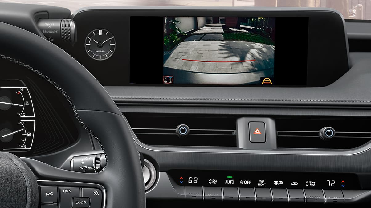 Interior of the 2019 UX featuring backup camera capabilities on the multimedia display.