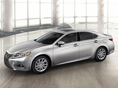 Exterior shot of the 2018 Lexus ES Hybrid shown in Silver Lining Metallic.
