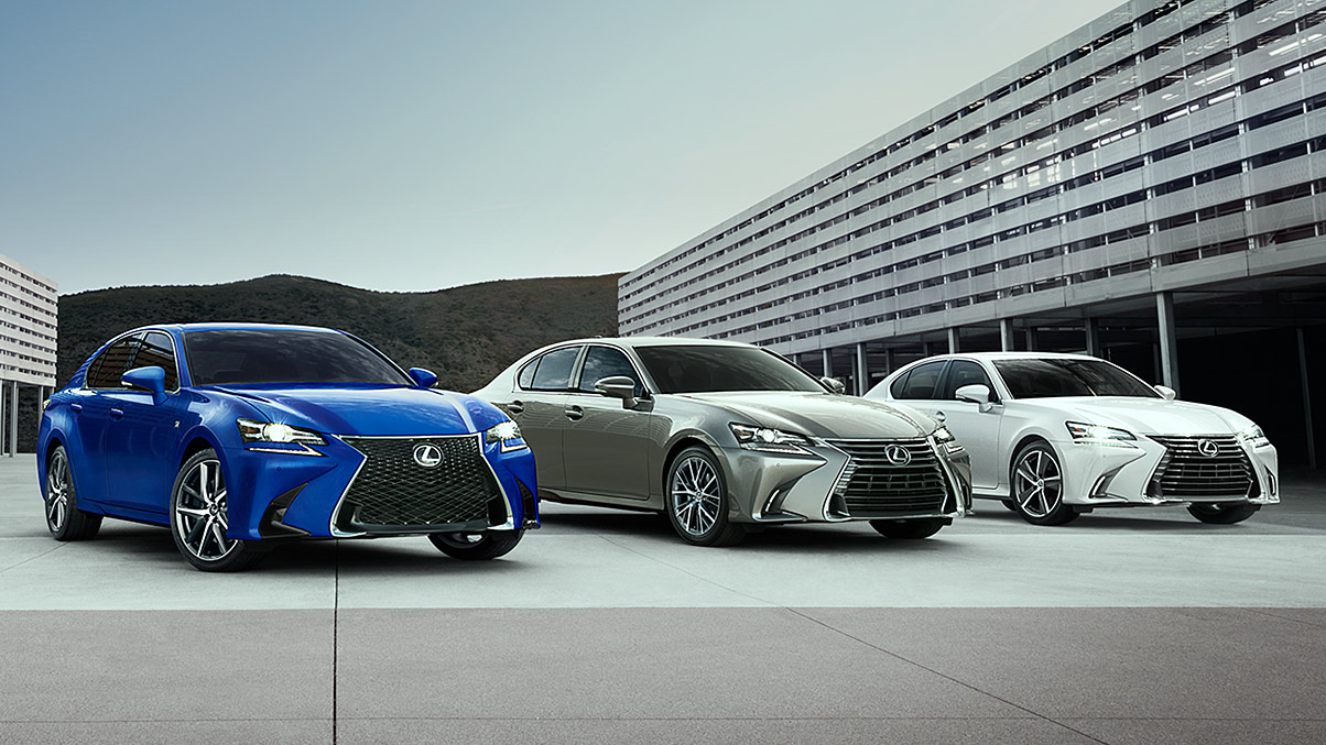 Lexus GS F SPORT shown in Ultrasonic Blue Mica 2.0 and the Lexus GS shown in Atomic Silver and Eminent White Pearl