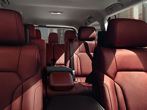 Interior shot of the Lexus LX in available Cabernet semi-aniline leather and Linear Espresso wood interior trim.