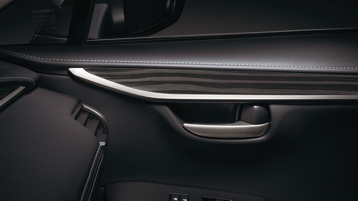 Interior shot of the 2019 Lexus NX shown with Linear Black Shadow wood trim