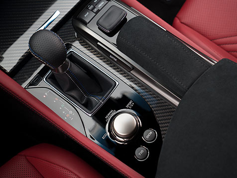 Interior of the Lexus GS F showing the Drive Mode Select knob and Remote Touch.