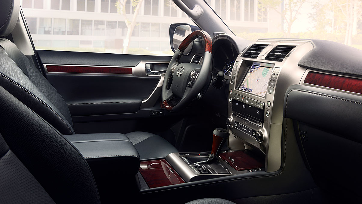 Interior shot of the 2019 Lexus GX 460 shown with Black leather and Mahogany wood trim.