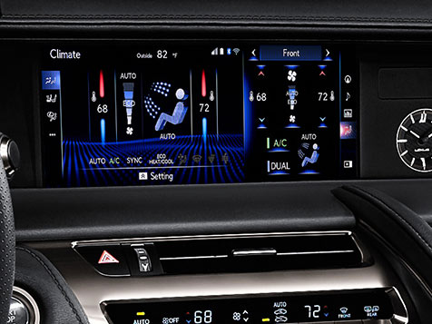 Interior detail shot of the LC 500 showing the 10.3-inch multimedia display with Dual-zone climate control and Climate Concierge.