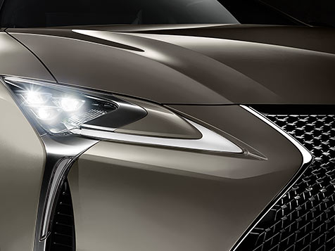 Detail shot of the Lexus LC 500h shown in Atomic Silver featuring the Premium Triple-Beam LED headlamps.