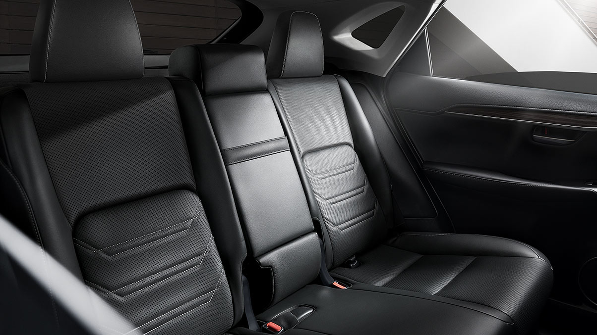 Interior of Lexus NX showing rear seat detail in available Black leather trim.