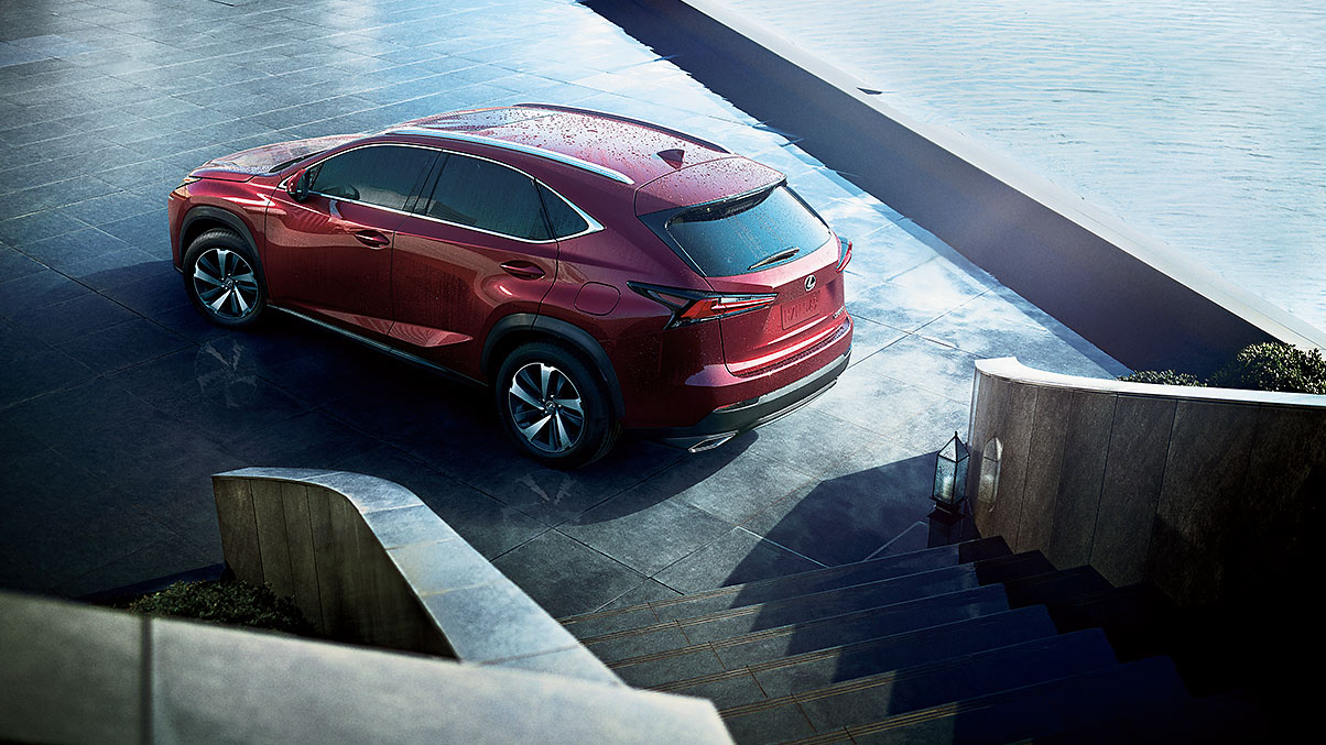 Exterior shot of the 2019 Lexus NX shown in Matador Red Mica