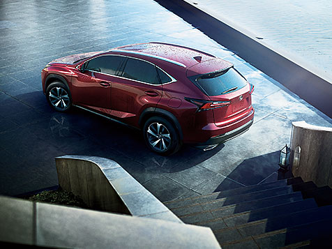 Lexus NX shown in Matador Red Mica.