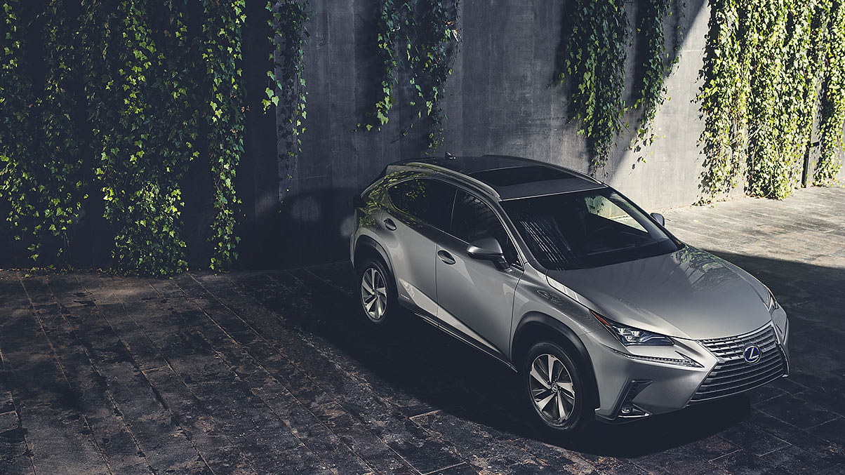 Exterior shot of the 2018 Lexus NX Hybrid shown in Atomic Silver