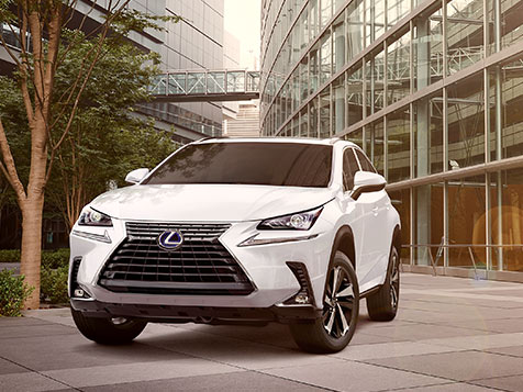 Exterior shot of the 2019 Lexus NX Hybrid shown in Eminent White Pearl