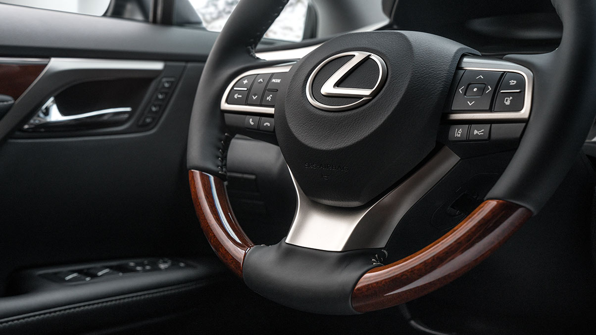 Close-up of the heated wood and leather steering wheel available on the 2019 Lexus RXL.