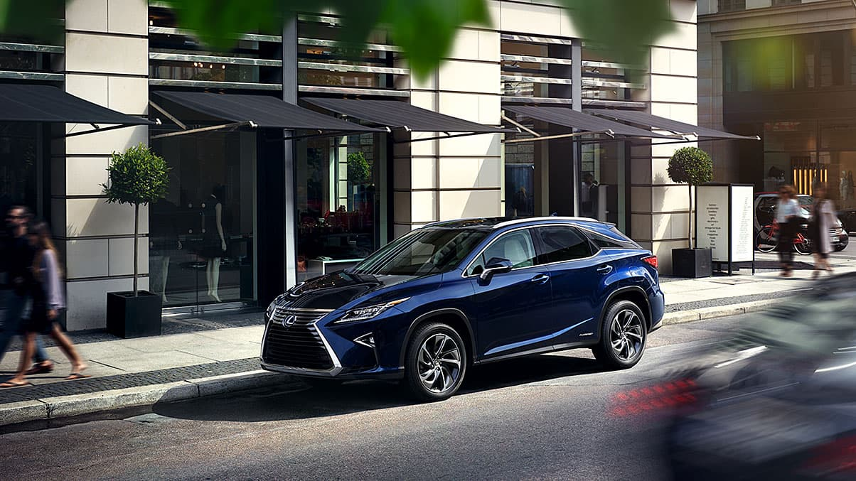 Exterior shot of the 2019 Lexus RX Hybrid shown in Nightfall Mica.