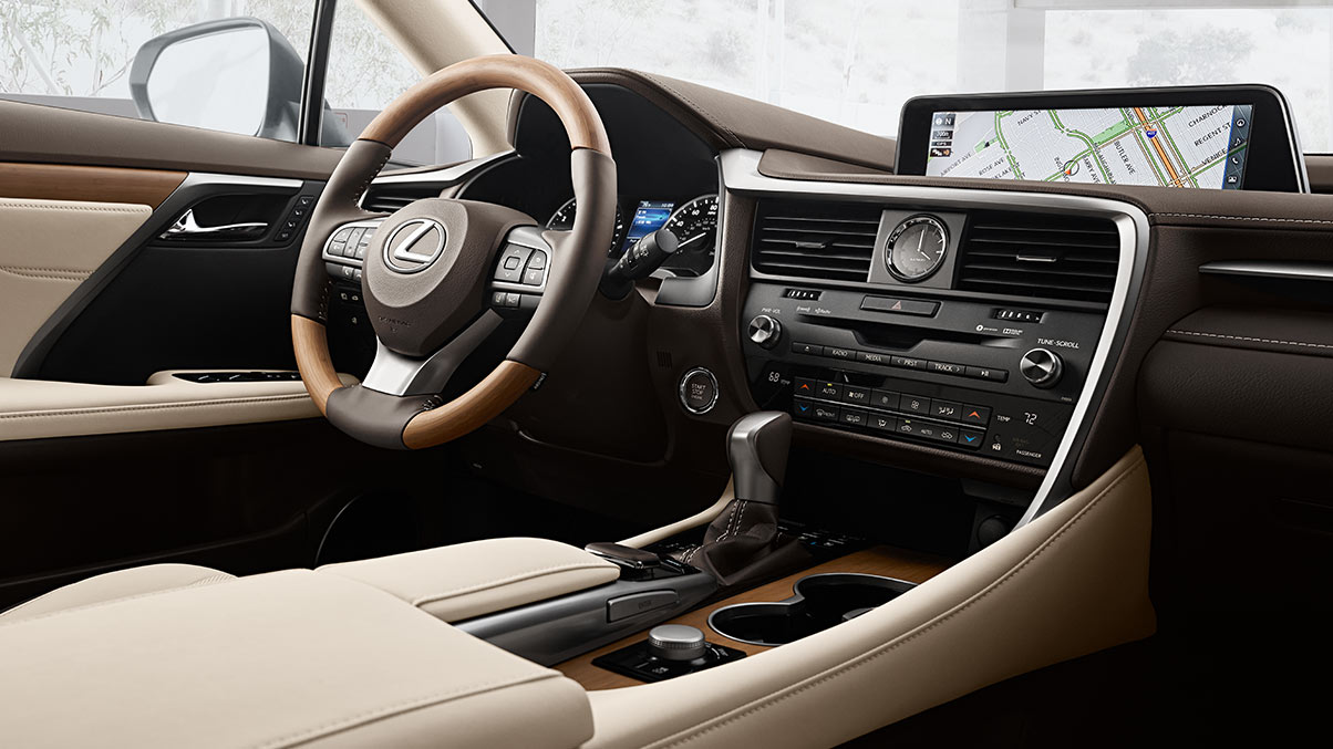 Interior shot of the 2018 Lexus RX shown with available Parchment leather and Matte Bamboo trim.