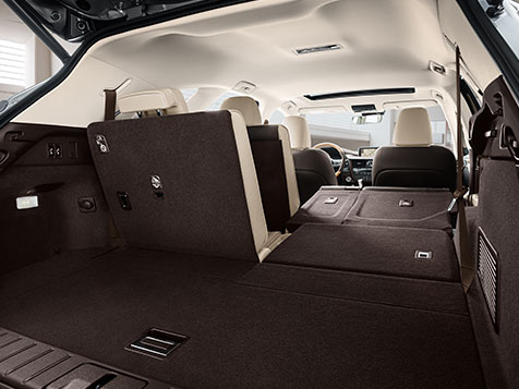 The seven-passenger 2019 Lexus RXL has three rows of power-folding seats. Looking through the cabin from the trunk, the right-hand side of rows two and three are folded down.