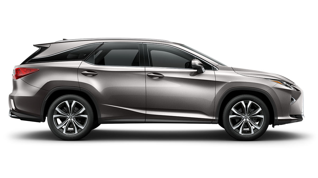 Laterial view of the 2019 Lexus RXL luxury SUV rear, back right tire and wheels. Shown in the Atomic Silver color option.