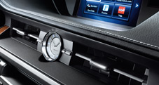 2013 Lexus ES 300h Hybrid dashboard shown with analog clock with silver-plated bezel and auto-illuminating face