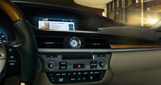 2013 Lexus ES 300h Hybrid interior dashboard shown with available Parchment leather and Bamboo trim