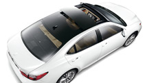 2013 Lexus ES 350 shown in Starfire Pearl with available panorama glass roof and 18-inch split-10-spoke alloy wheels