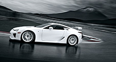 LFA shown in Whitest White, active rear wing with Gurney Flap deployed.