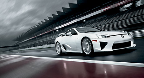 2013 LFA shown in Whitest White, active rear wing with Gurney Flap deployed.
