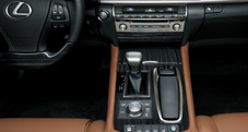 Remote Touch and Drive Mode Select center console shown with Shimamoku wood accent in 2013 Lexus LS