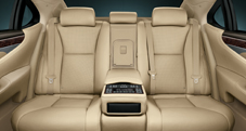 2013 Lexus LS interior back seat shown in Parchment leather trim with Dark Brown Walnut accent